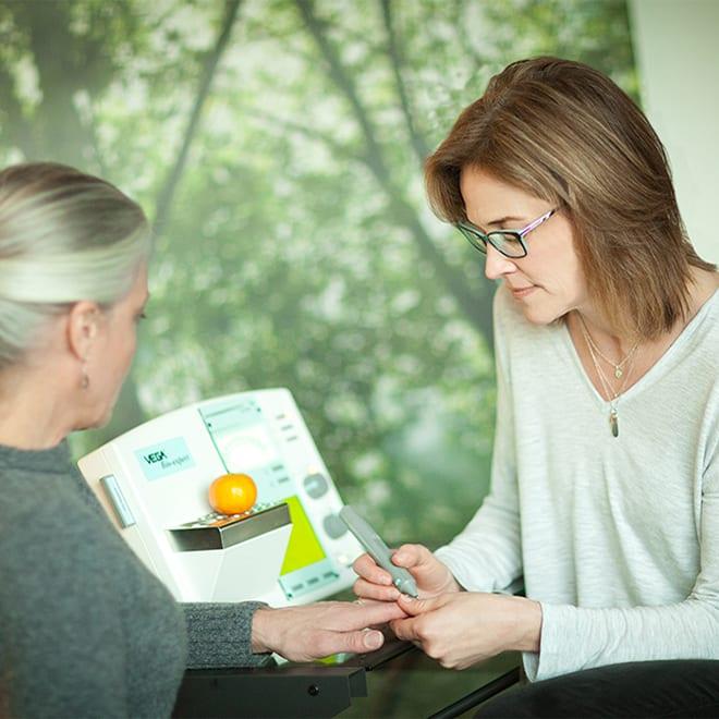 Dr Brenda McCool discusses a food sensitivity test with a patient.