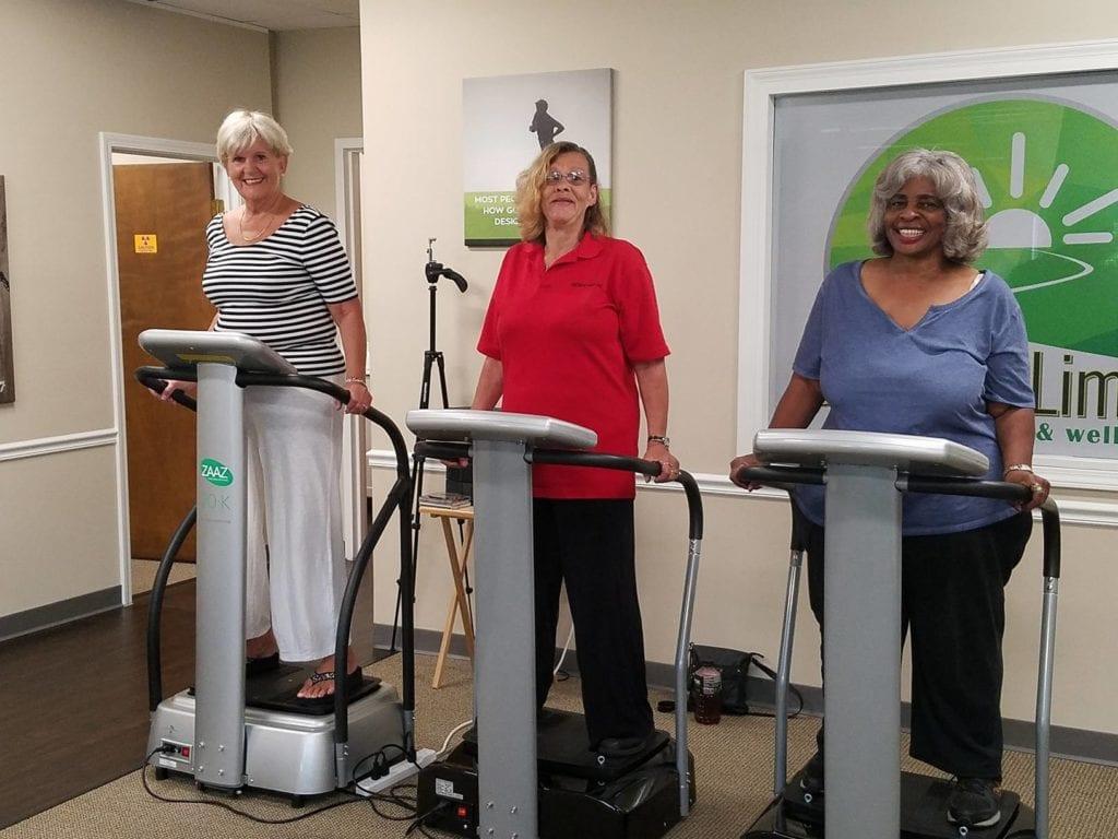 3 women standing on machines
